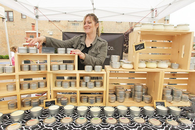 Candace H. Johnson-For Shaw Media Erika Tames, of Chicago with the ZuZu Candle Co. sells hand poured premium soy wax candles at the Spring Grayslake Farmers Market on Center Street in downtown Grayslake. The Spring Market runs on Saturdays through May 26th from 10-2:00 pm. (5/19/18)
