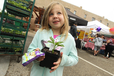 Candace H. Johnson-For Shaw Media Shannon Quinn, 6, of Grayslake holds a red pepper plant for sale by Geneva Lakes Produce at the Spring Grayslake Farmers Market on Center Street in downtown Grayslake. The Spring Market runs on Saturdays through May 26th from 10-2:00 pm. and the Summer Market runs on Wednesdays May 30- September 26 from 3-7:00 pm. (5/19/18)