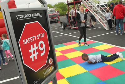 Candace H. Johnson-For Shaw Media Julia Paukert, of Gurnee teaches Chace Gordon, 4, of North Chicago how to Stop, Drop and Roll during the 21st Annual Fire Safety Expo at Gurnee Mills.Paukert was a volunteer from Warren Township High School's FBLA Chapter.(5/19/18)