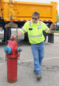 Candace H. Johnson-For Shaw Media Chris Chamberlain, maintenance man II with the Gurnee Public Works Department, talks about how the Village of Gurnee maintains their fire hydrants during the 21st Annual Fire Safety Expo at Gurnee Mills.There are approximately 2500 fire hydrants in Gurnee.(5/19/18)