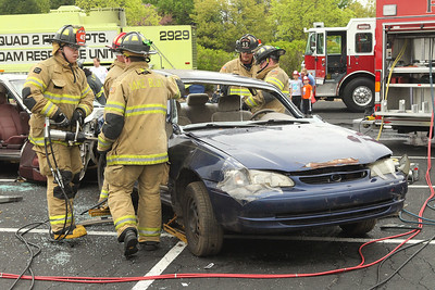 Candace H. Johnson-For Shaw Media Lake Bluff firefighters tear apart a car during an auto extrication demo at the 21st Annual Fire Safety Expo at Gurnee Mills.(5/19/18)