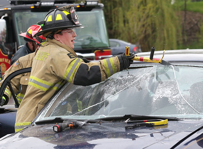 Candace H. Johnson-For Shaw Media Firefighter Connor Adams with the Lake Bluff Fire Department, cuts open a car windshield during an auto extrication demo during the 21st Annual Fire Safety Expo at Gurnee Mills.(5/19/18)