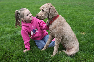 Candace H. Johnson-For Shaw Media Harper Jane Kubiak, 6, with her dog, Rosie Star, in the backyard of her home in Lake Forest.(5/21/18)