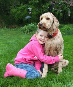 Candace H. Johnson-For Shaw Media Harper Jane Kubiak, 6, gives a hug to her dog, Rosie Star, in the backyard of her home in Lake Forest.(5/21/18)
