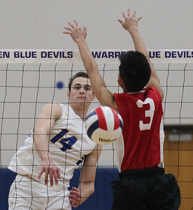 Candace H. Johnson-For Shaw Media Warren's Ethan Fabrie makes an attack past the block by Jefferson's Noah Chanthalangsy in the second set during the regional semifinal game at Warren Township High School. Warren won 25-19, 25-23.(5/22/18)
