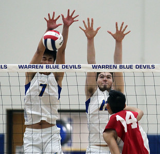 Candace H. Johnson-For Shaw Media Warren's Alex Jiang and Kyle Wells go up for a block against an attack by Jefferson's Nolan Phapheelom in the first set during the regional semifinal game at Warren Township High School. Warren won 25-19, 25-23.(5/22/18)