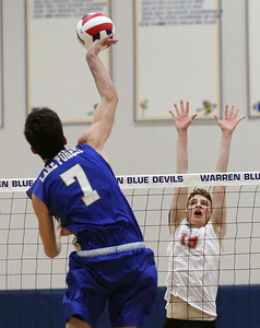 Candace H. Johnson-For Shaw Media Grant's Ian Fox (#19) looks to block an attack by Lake Forest's Joe Chamberlain in the first set during the regional semifinal game at Warren Township High School. Lake Forest won 25-18, 25-20.(5/22/18)
