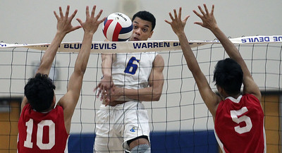 Candace H. Johnson-For Shaw Media Warren's Freddy Harris (#6) goes up for an attack against Jefferson's Joshua Concepcion and Daniel Luangnikone in the second set during the regional semifinal game at Warren Township High School. Warren won 25-19, 25-23.(5/22/18)