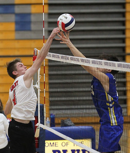 Candace H. Johnson-For Shaw Media Grant's Garrett Seymour works on tipping the ball past Lake Forest's Justin McCartney in the second set during the regional semifinal game at Warren Township High School. Lake Forest won 25-18, 25-20. (5/22/18)