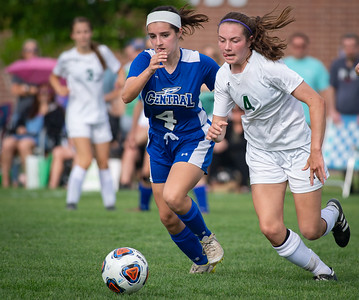 Crystal Lake South's Emma Chudik, right, races Burlington Central's Reagan Oller to the ball during the second half of the 2A Rochelle Sectional final game on Friday, May 25, 2018. CLS lost the game 3-1. Randy Stukenberg for Shaw Media