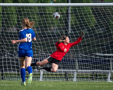 Crystal Lake South goalkeeper Marissa Ketter tries to block a kick on the goal during the second half of the 2A Rochelle Sectional final game on Friday, May 25, 2018. CLS lost the game 3-1. Randy Stukenberg for Shaw Media