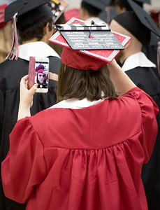 Sam Buckner for Shaw Media. Jillian Hooker adjusts her cap using the front facing camera on her phone on Saturday May 26, 2018.
