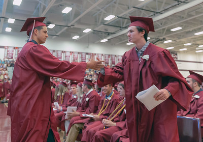 Graduates of Richmond-Burton's class of 2018 congratulate each other Sunday, May 27, 2018 in Richmond.  KKoontz – For Shaw Media