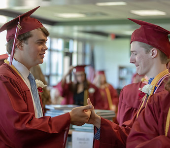 Students of Richmond-Burton's class of 2018 congratulate each other before the graduation ceremony Sunday, May 27, 2018 in Richmond.  KKoontz – For Shaw Media