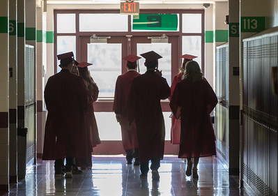 Students of Richmond-Burton High School make their way outside before the graduation ceremony Sunday, May 27, 2018 in Richmond.  KKoontz – For Shaw Media