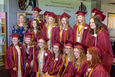 Students from Richmond-Burton High School pose for photos before the 2018 Graduation Ceremony Sunday, May 27, 2018 in Richmond. KKoontz – For Shaw Media