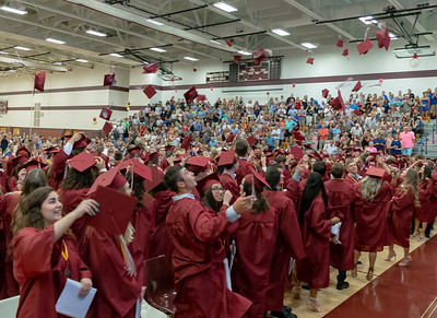 Graduates of Richmond-Burton's class of 2018 toss their caps in the air Sunday, May 27, 2018 in Richmond.  KKoontz – For Shaw Media