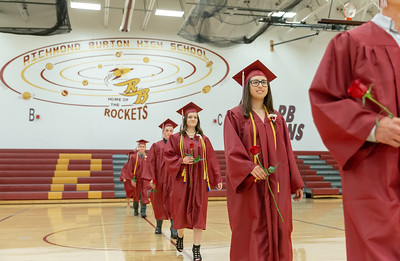 Students from Richmond-Burton High School make their way into the gymnasium for the 2018 Graduation Ceremony Sunday, May 27, 2018 in Richmond.  KKoontz – For Shaw Media