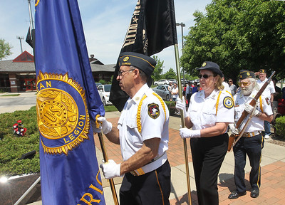 Candace H. Johnson-For Shaw Media Dwain Chittom, of Libertyville, Jan Billings, of Gurnee, and Bill Frangquist, of Lake Forest, members of the American Legion Color Guard walk together during the Retirement of Colors for the Annual Memorial Day Ceremony at the Gurnee Memorial on O'Plaine Road in Gurnee.The ceremony was presented by American Legion Post 771 and the Village of Gurnee.(5/28/18)