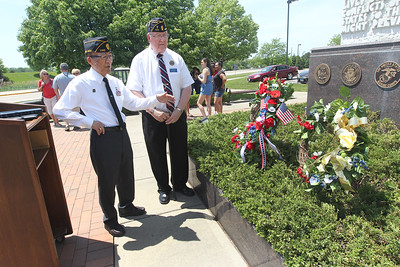 Candace H. Johnson-For Shaw Media James Mukoyama, Jr. of Glenview, Major General, United States Army Retired, and Larry Peters, Air Force veteran and American Legion Post 771 Chaplain, look at the memorial wreaths placed at the Gurnee Memorial during the Annual Memorial Day Ceremony in Gurnee.(5/28/18)
