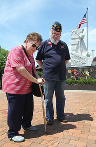 Candace H. Johnson-For Shaw Media Nancy and Bob Long, of Gurnee look for a memorial brick honoring Nancy's grandfather, Oscar Liebert, U.S. Army Coast Grd,1878-1967 inscribed on it after the Annual Memorial Day Ceremony at the Gurnee Memorial on O'Plaine Road in Gurnee.Bob Long is the past commander of the Gurnee American Legion Post 771.(5/28/18)