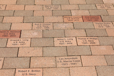 Candace H. Johnson-For Shaw Media Bricks honoring those who have served in the military stand in front of the Gurnee Memorial on O'Plaine Road in Gurnee.(5/28/18)