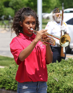 "Candace H. Johnson-For Shaw Media Daniella Alba, 12, of Gurnee plays ""Taps"" on her trumpet during the Annual Memorial Day Ceremony at the Gurnee Memorial on O'Plaine Road in Gurnee.The ceremony was presented by American Legion Post 771 and the Village of Gurnee.(5/28/18)"
