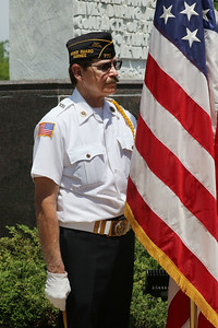 Candace H. Johnson-For Shaw Media Al Billings, of Wildwood, a Navy veteran, with American Legion Post 771 stands with the American flag during the Annual Memorial Day Ceremony at the Gurnee Memorial on O'Plaine Road in Gurnee.The ceremony was presented by American Legion Post 771 and the Village of Gurnee.(5/28/18)