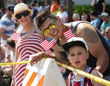 Candace H. Johnson-For Shaw Media Natalie and Jose Perez, of Wauconda and their son, Ascher, 6, watch the Wauconda Memorial Day Parade.(5/28/18)