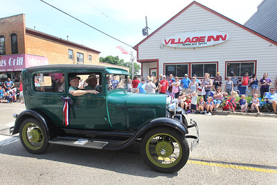 Candace H. Johnson-For Shaw Media John Lahr, of Volo rides with Jim Raupp, of Lake Zurich as he drives his 1929 Ford Model A down Main Street during the Wauconda Memorial Day Parade.(5/28/18)