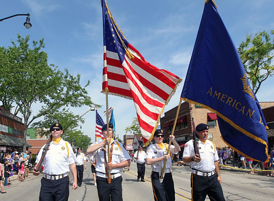 Candace H. Johnson-For Shaw Media The American Legion Post 911 Color Guard walks down Main Street during the Wauconda Memorial Day Parade.(5/28/18)