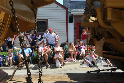 Candace H. Johnson-For Shaw Media The crowd watches huge trucks and machinery go by from Berger Excavating Contractors, of Wauconda as they make their way down Main Street during the Wauconda Memorial Day Parade.(5/28/18)