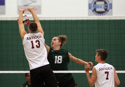 Candace H. Johnson-For Shaw Media Antioch's Josh Lahti blocks an attack by Grayslake Central's Nick Murphy in the first set at Grayslake Central High School. Antioch won 25-21, 25-19. (4/30/19)