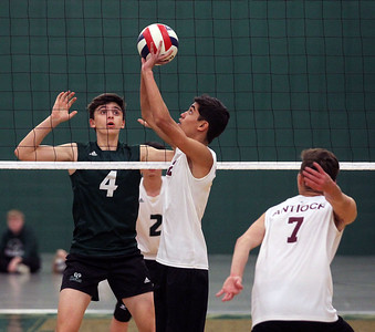 Candace H. Johnson-For Shaw Media Grayslake Central's Tyler Armstrong watches the ball being set by Antioch's Trevor Niznik in the first set at Grayslake Central High School. Antioch won 25-21, 25-19. (4/30/19)