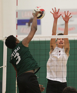Candace H. Johnson-For Shaw Media Grayslake Central's Emmanuel Eugene makes an attack against Antioch's Kyle Jilly in the second set at Grayslake Central High School. Antioch won 25-21, 25-19. (4/30/19)