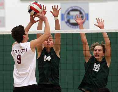 Candace H. Johnson-For Shaw Media Antioch's Dominic Scornavacco tries to get over the block by Grayslake Central's Isaac Dahlstrom and Nick Murphy in the first set at Grayslake Central High School. Antioch won 25-21, 25-19. (4/30/19)