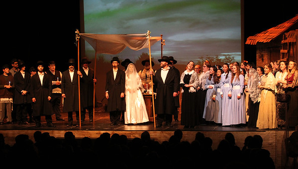 Candace H. Johnson-For Shaw Media The cast celebrates the wedding of Motel (Ben Bryson) and Tzeitel (Alyssa Graves) during Fiddler on the Roof at Carmel Catholic High School in Mundelein. (4/27/19)