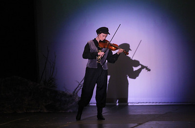 Candace H. Johnson-For Shaw Media Ericka Beckman plays her violin as the Fiddler at the end of Act II during Fiddler on the Roof at Carmel Catholic High School in Mundelein. (4/27/19)