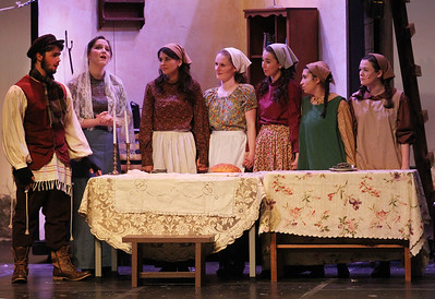 "Candace H. Johnson-For Shaw Media Tevye (Mark May) and Golde (Maggie Bodo) sing the ""Sabbath Prayer"" to their daughters during Fiddler on the Roof at Carmel Catholic High School in Mundelein. (4/27/19)"