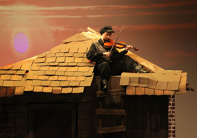 Candace H. Johnson-For Shaw Media Ericka Beckman plays her violin as the Fiddler at the start of Act I during Fiddler on the Roof at Carmel Catholic High School in Mundelein. (4/27/19)