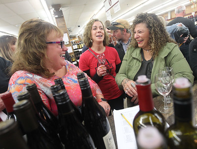 Candace H. Johnson-For Shaw Media Sherri Arizmendi, of Wadsworth, Kristin Cassidy, of Lake Geneva, Wis., and Bobbie Miranda, of Antioch share a laugh during the 33rd Annual Spring Wine Tasting at Antioch Fine Wine & Liquors in Antioch. Over 120 wines were sampled. (4/27/19)