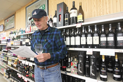 Candace H. Johnson-For Shaw Media Phil Schultz, of Antioch checks over the wine list of wines featured during the 33rd Annual Spring Wine Tasting at Antioch Fine Wine & Liquors in Antioch. Over 120 wines were sampled at the free event. (4/27/19)