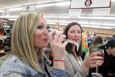 Candace H. Johnson-For Shaw Media Nikki Vostater, of Lindenhurst and Tiffany Pulsha, of Beach Park try different wines during the 33rd Annual Spring Wine Tasting at Antioch Fine Wine & Liquors in Antioch. Over 120 wines were sampled. (4/27/19)