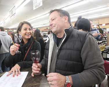 Candace H. Johnson-For Shaw Media Hilary and Jhan Dolphin, of Lake Villa try different red wines during the 33rd Annual Spring Wine Tasting at Antioch Fine Wine & Liquors in Antioch. Over 120 wines were sampled. (4/27/19)