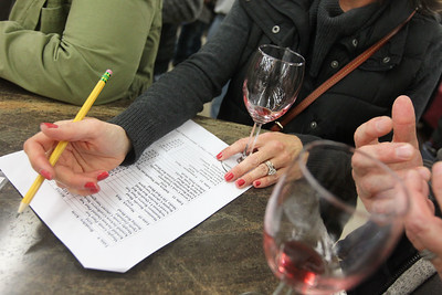 Candace H. Johnson-For Shaw Media Hilary Dolphin, of Lake Villa looks over the wine list of featured wines during the 33rd Annual Spring Wine Tasting at Antioch Fine Wine & Liquors in Antioch. Over 120 wines were sampled. (4/27/19)