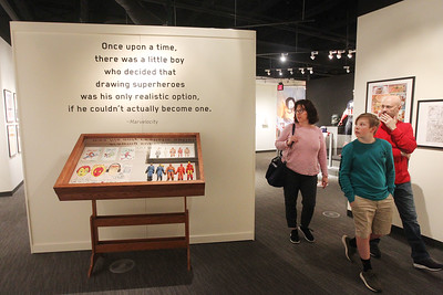 Candace H. Johnson-For Shaw Media Karen and Rich Angelbeck, of Libertyville and their son, Grant, 12, walk through the Marvelocity:The Art of Alex Ross exhibit during Free Comic Book Day at the Bess Bower Dunn Museum in Libertyville. (5/4/19)