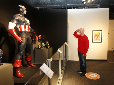 Candace H. Johnson-For Shaw Media Rich Angelbeck, of Libertyville enjoys looking at a life-size Captain America statue on display in the Marvelocity:The Art of Alex Ross exhibit at the Bess Bower Dunn Museum in Libertyville. (5/4/19)