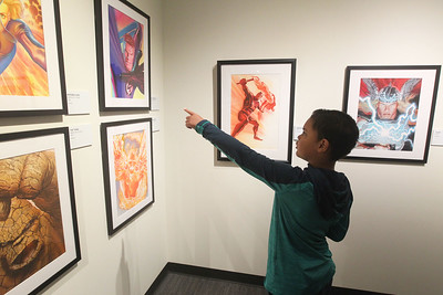 Candace H. Johnson-For Shaw Media William A.,9,  of Park City looks at gouache paintings by comic book artist, Alex Ross, in the Marvelocity:The Art of Alex Ross exhibit during Free Comic Book Day at the Bess Bower Dunn Museum in Libertyville. (5/4/19)