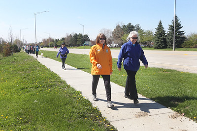 Candace H. Johnson-For Shaw Media Deb Reinemann and Barbara Stevens, both of Gurnee lead the way on Dilleys Road during the Go Gurnee Walk after starting at 1821 N. Dilleys Road near the water tower in Gurnee. The Go Gurnee Walk is presented by the Gurnee Park District. The walks are scheduled at different locations every Saturday from 9:30-11:00 am. The next walk will be on Saturday, May 11th, at 9:30 am at Illinois Beach State Park. (5/4/19)