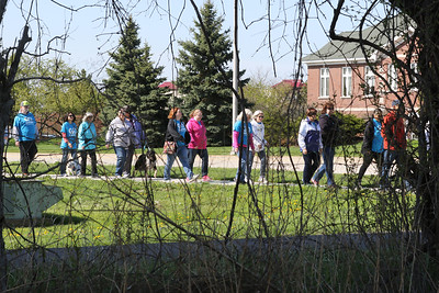 Candace H. Johnson-For Shaw Media A group of walkers stay together on Dilleys Road as they get close to a wooded area during the Go Gurnee Walk which started out at 1821 N. Dilleys Road in Gurnee. The Go Gurnee Walk is presented by the Gurnee Park District. The walks are scheduled at different locations every Saturday from 9:30-11:00 am. The next walk will be on Saturday, May 11th, at 9:30 am at Illinois Beach State Park. (5/4/19)